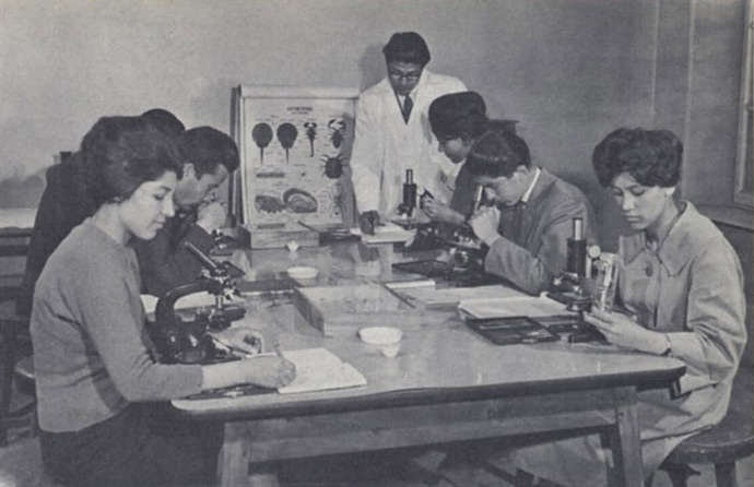"""Biology class, Kabul University."" In the 1950s and '60s, women were able to pursue professional careers in fields such as medicine. Today, schools that educate women are a target for violence, even more so than five or six years ago."