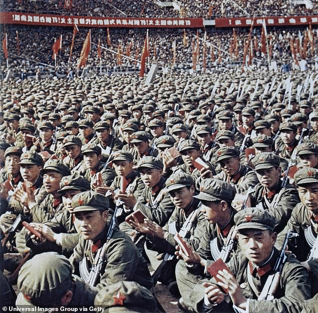 'It is not far-fetched to compare the methods of this 'woke movement' to those of Chairman Mao's Red Guards, who terrorised the Chinese people half a century ago,' says John Gray. Pictured: Red Guards reading Mao's Little Red Book in Beijing, 1966