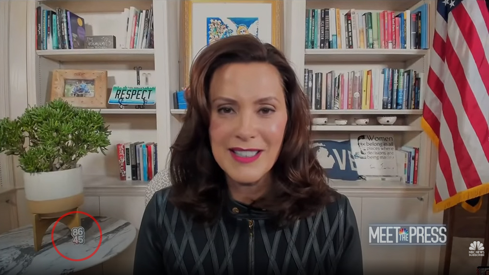 Image: Michigan Gov. Whitmer (who loves to play VICTIM) displays symbols during live interview that call for assassination of President Trump